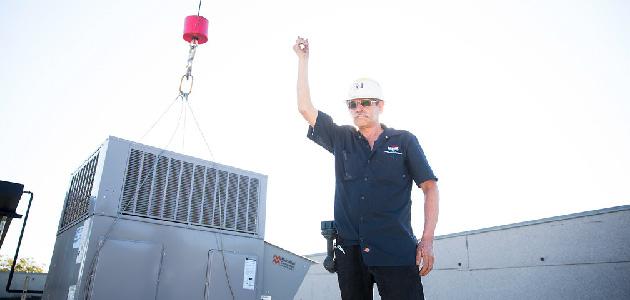HVAC technicians installing system.